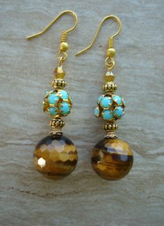 Tiger eye Dangle earrings featuring a round faceted tiger eye stone and accented with Swarovski crystals and aqua stone ball. Earwire are vermeil. Boho Jewelry, Jewelry Crafts, Beaded Jewelry, Jewelery, Jewelry Design, Tiger Eye Earrings, Tiger Eye Jewelry, Homemade Jewelry, Bead Earrings