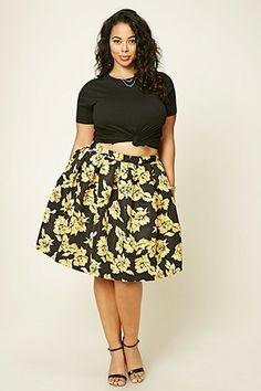 I love this skirt. It could be toned down with a long sleeve blouse,  canary yellow cardigan, black tights or leggings, and  a pair of gold or black booties.
