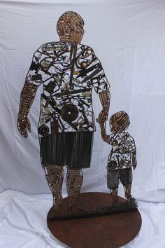 This is a piece from a couple of years ago, it captures the bond between father and son. Created from recycled materials. Recycled Art, Recycled Materials, Scrap Metal Art, Build Something, Metal Artwork, The 5th Of November, Father And Son, Street Art, Art Pieces