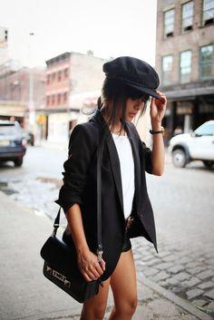 baker hat, black blazer, white crew neck t-shirt, black belt, denim shorts, nike sneakers, black handbag, low messy bun