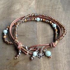 This gemstone bracelet is made with Amazonite beads, Miyuki beads ,leather, a metal flower charm and a metal clasp. Fits a wrist of 20 cm = 7.87 inch. Please read my policies before ordering.
