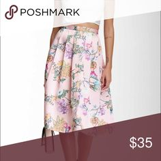 Floral A-Line Skirt 29 inches long. Label reads L but fits a Medium. Pleats and silk material. 15 inches at the waist. Skirts Midi