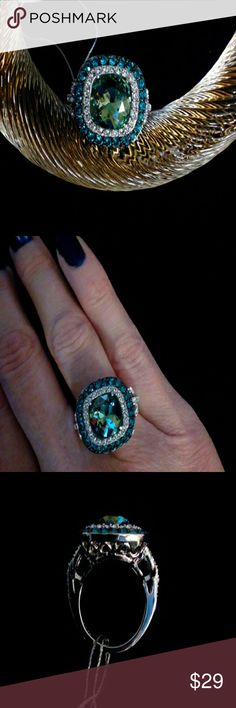 Sz6 Sterling Swarvoski Halo ring Solid sterling silver with platinum plating for protection. Swarvoski light green cushion cut crystal surrounded by double halo of clear and aqua blue crystals. Stunning, beautiful colors. Scrollwork setting and clear crystal details on sides. Stone weight 3.88 carats. NWT, stamped 925, comes in gift box. Sz 6. Jewelry Rings