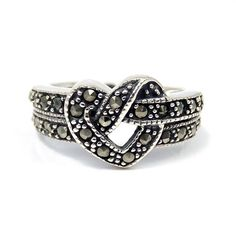 Beautitul Heart Knot Marcasite .925 Silver Ring (Thailand). I swear I had a ring like this at one point.