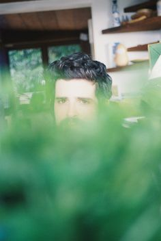 Devendra through a parsley bouquet