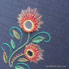 shisha embroidery with metallic threads on dark fabric
