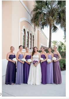 Different shades of purple for bridesmaids.  Beautiful!
