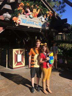 Family Halloween costume - Tigger, Winnie the Pooh and a baby bumble bee in a honey pot baby carrier. Great way to wear your baby for the holiday.