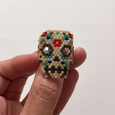 Amazing Hand Made Calavera Ring *Hand Made from artisans of Jalisco, Mexico.        *Czech Crystals.                                                          *Swarovski crystals (eyes).                                          *Wixarika art                                                           *One size, fits size 6.5                                              *Price is FIRM! Urban Outfitters Jewelry Rings