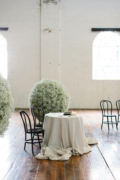 modern wedding with giant life size baby's breath balls for decor. Photo: Erin & Tara