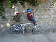 "Works really well and he loves it! Brompton folding bike with Bobike Mini child seat and custom bracket ordered from the Dutch Trading Company:   www.conwasa.demon.co.uk/bobike/bobike_brackets.htm    Scroll down to ""MINI-1 FRAME BRACKET""    The seat is the Bobike Mini:  www.bobike.nl/products/en/bobike_mini+.htm?fluxmenu=m9____m2"