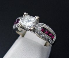 Princess Cut Diamond / Ruby Ring in 14k White Gold... my two favorite gems. Will someone please show this to my future husband so he has an idea???