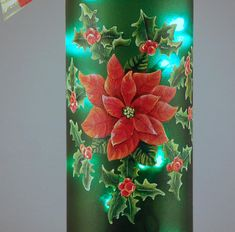 Welcome your holiday party guests to your holiday buffet or home bar with this festive wine bottle lamp. This lamp was created from a rescued empty green wine bottle. A hole was drilled in the back of the bottom to allow a plug-in string of Christmas lights to be inserted into the
