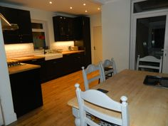 Open plan kitchen diner with IKEA LAXARBY kitchen and dining table painted in Annie Sloan Paris Grey Chalk Paint