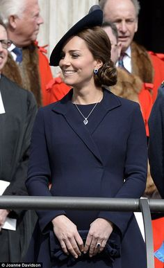 Cheerful: The Duchess looked happy and relaxed as she joined fellow royals and veterans for a flypast outside the cathedral