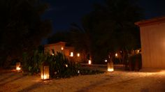 DarZahia's garden at night lit by candles.
