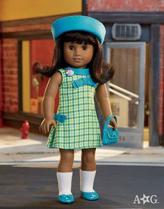 I'm absolutely so in love with this precious doll, from hair to her outfit hopefully Santa clause will be leaving her under my Christmas tree -American Girl Fan