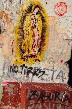 "street art Lady of Guadalupe with ""Don't litter"" written underneath in Spanish."