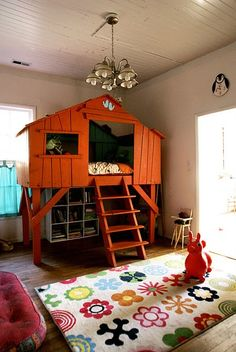 red barn bunk bed with wide plank ladder leading up to it, gender neutral space…