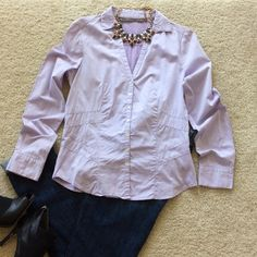 "Zara basic blouse Zara Basic lilac colored blouse. Buttons majority of the way up with a V neck. Form fitting. Easy to wear for the office or weekend errands. Approx 24.5"" shoulder to hem. 100% cotton. Size M. Great condition Zara Tops Blouses"
