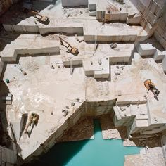 Gigantic blocks of marble are carved out like enormous sugar cubes, cleaved from the mountainside with the careful encouragement of huge diggers.