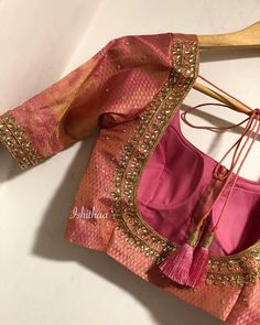 I cannot explain in words how much I love this colour ! Stunning pink color designer blouse with hand embroidery kundan work.Ping on 9884179863 to book an appointment. Cutwork Blouse Designs, Pattu Saree Blouse Designs, Simple Blouse Designs, Bridal Blouse Designs, Blouse Neck Designs, Designer Blouse Patterns, Embroidery Blouses, Hand Embroidery, Blouse Desings