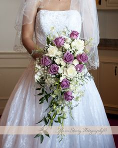 Traditional cascading purple lavender and white wedding bouquet