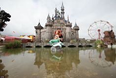 A mermaid piece by Banksy, with a castle by Banksy and Block 9 in the background, during the press view for the artist's biggest show