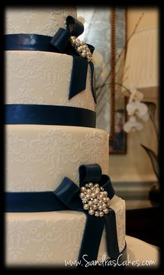 White cake.  White fondant, with the blue fondant as ribbon.  Maybe white roses in place of the gaudy brooch things.
