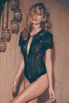 - Stretch lace - Front keyhole - Button detailing - Neck and waist tie closure - Lycra paneling - Open back - Thong back - Unlined - Snaps at gusset