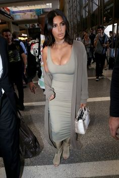 Kim Kardashian and Kanye West are spotted at LAX.
