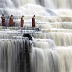 Monks passing Vietnam's Pongua Falls