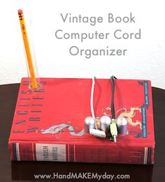 A unique cord organizer with vintage book. Crafts From Recycled Materials, Man Crafts, Diy Ideas, Craft Ideas, Cord Organization, Cable Organizer, Hobbies And Interests, Livingston, Altered Books