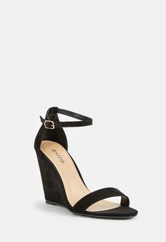 db0978de9e4 A wedge sandal with a sleek two-strap design and adjustable ankle strap  buckle closure