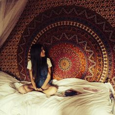 Beautiful tapestry behind the bed or the couch, love it