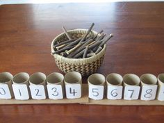 One to one correspondance with toilet paper tubes and a basket full of sticks - preschool math activities