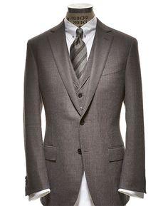 Zegna Centennial 3-Piece Two-button Centennial Fabric No. 1 suit ($3,295), vest ($900), cotton-and-silk shirt with collar bar ($395), and silk tie ($175) by Ermenegildo Zegna. Read more: Ermenegildo Zegna Suit Review - Zegna Centennial Suit - Esquire http://www.esquire.com/blogs/mens-fashion/ermenegildo-zegna-suit-review-0910#ixzz2Ojr0qe5A