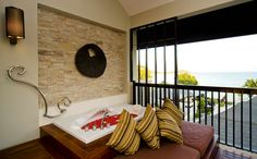 Balcony of Sareeraya Suite Jacuzzi Sea View (70sq. meters). Listen to the sounds of the surroundings and enjoy the views!