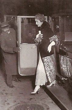 The octogenarian Mrs. Hamilton McKown Twombly alighting from her limousine to attend an opening night at the old Metropolitan Opera on 39th Street and Seventh Avenue, circa 1930.