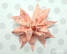 Step by step spiker bow tutorial with pictures for every stop. Easy to follow instructions for making a spiker hair bow from grosgrain ribbon.