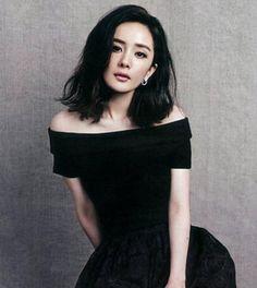Stark black. Shoulder length wavy bob