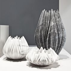 Pleats sculptured into marble--Tau Vases by Zaha Hadid for Citco