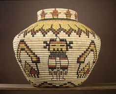 Award-Winning Hopi Second Mesa Basket by Joyce Ann Saufkie | finely woven yucca basket depicting a row of Mudheads along neck, body with alternating Crow Mother and Katsinmana, each separated by elaborate rain clouds