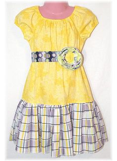 This website has the cutest lil girl dresses! All made to actually play in... My daughter has a handful of them- LOVE them! Plaid Sunshine Peasant Dress - 3T/4T