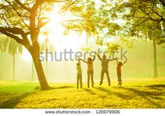 Rear view of joyful happy Asian family jumping together at outdoor park - Shutterstock Premier
