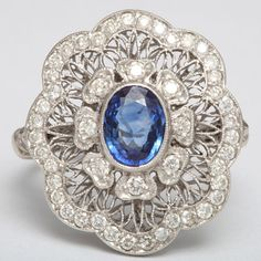 Edwardian Sapphire And Diamond Flower Ring   From a unique collection of vintage cocktail rings at http://www.1stdibs.com/jewelry/rings/cocktail-rings/