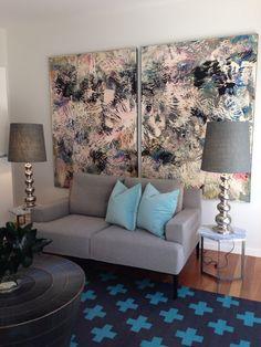 Modern art behind sofa