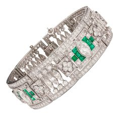 Art Deco Emerald Diamond Platinum Panel Bracelet. Stunning Art Deco Platinum Link Bracelet Adorned with Marquise and Round Cut Diamonds and 24 Vibrant Emeralds. The three largest marquise cut diamonds total approximately 3.35cts and average G color and SI clarity. The remaining diamonds total approximately 16.65cts. This bracelet is 7.0 inches long and 20mm wide and weighs 63.3 grams.