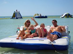 Family enjoying a floating cabana at TradeWinds Island Resorts