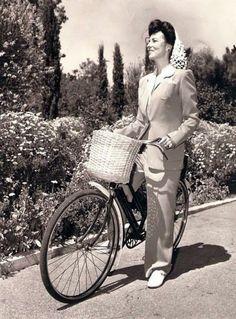 Agnes Moorehead rides a bike.